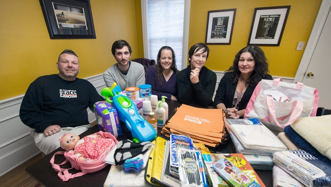 From the left, Rick Azzaro, Nick Silveri-Hiller, Joanie Taylor, Michelle Cooper and Jessica Castle, the community education team for ACCESS-York, are shown with examples of the donations they have received and need to help victims of domestic, sexual and other violence. This year, the York Daily Record/Sunday News decided to make the YWCA's domestic violence services the beneficiaries of its Christmas Emergency Fund, an annual drive that has benefited a variety of charitable organizations over the years.