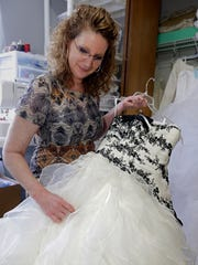Terri Nowicki takes portions of donated wedding gowns to be sewn into clothes for newborns and infants that do not survive as part of Sweet Send Aways.