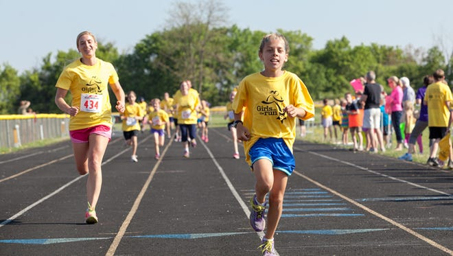 Third through eighth graders participate in the Girls on the Run 2013 5K.