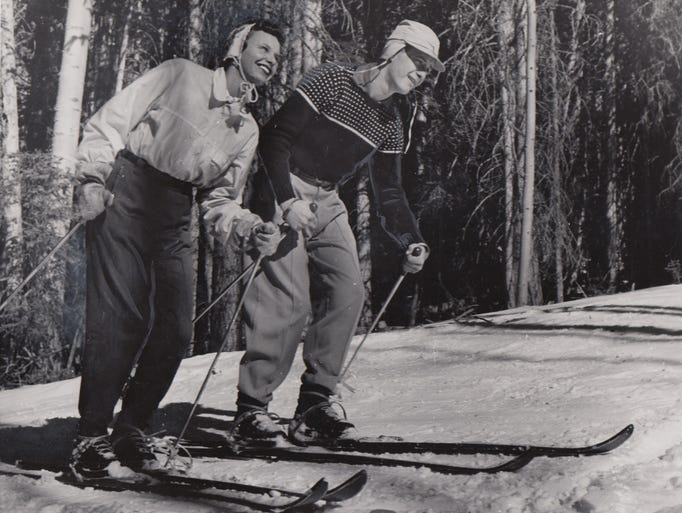 A couple enjoys skiing at Arizona Snowbowl near Flagstaff