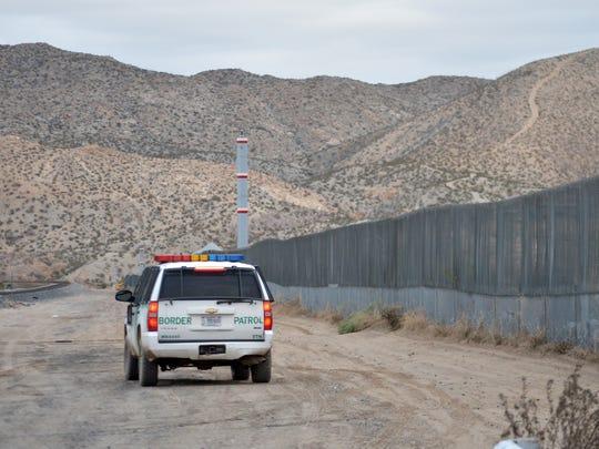 A U.S. Border Patrol agent drives on Jan. 4, 2016, near the U.S.-Mexico border fence in Sunland Park, N.M.