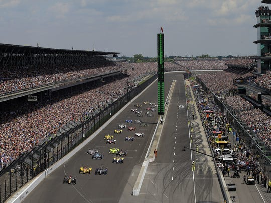 The field of 33 IndyCars take the green light at the start of the 100th running of the Indianapolis 500, May 29, 2016,