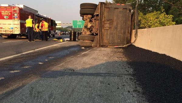 A dump truck carrying asphalt overturned on southbound I-95 near Exit 4 Monday morning.