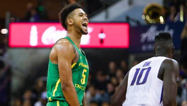 Jan 4, 2017; Seattle, WA, USA; Oregon Ducks guard Tyler Dorsey (5) reacts after making a three pointer against the Washington Huskies during the second half at Alaska Airlines Arena at Hec Edmundson Pavilion. Oregon defeated Washington, 83-61. Mandatory Credit: Joe Nicholson-USA TODAY Sports