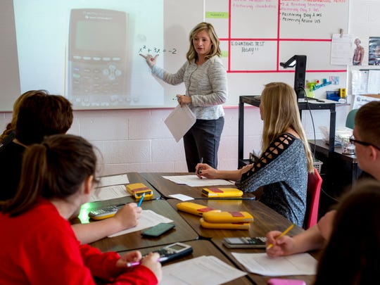"Lindsay Moran explains an equation to a group of students during an algebra class Thursday, Nov. 17, 2016 at Port Huron High School. Lindsay Moran is one of 10 teachers countywide awarded a $20,000 grant as part of the RESA ""Classrooms 4 the Future"" initiative."