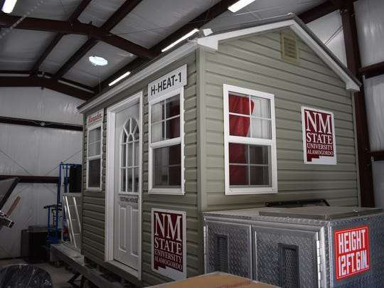 This mini house is used for students to conduct energy efficiency experiments on a home with air conditioning and heating systems.