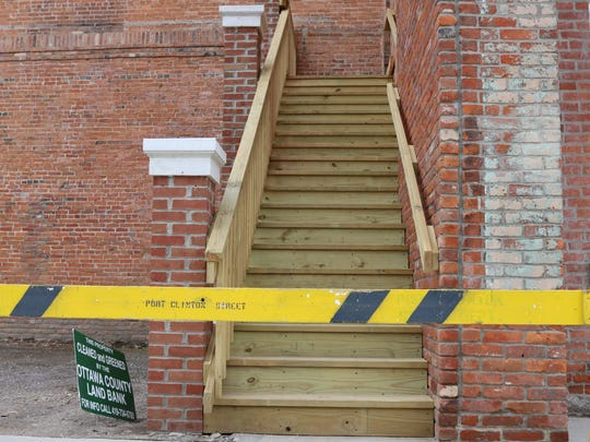 About seven feet of property, which includes these stairs, were transferred from 131 Madison Street to the property directly east.