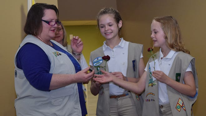 Girl Scout Troop 3428  leader Shannon Shelby (left) presents Christa Jeansonne (center) and her sister Cara Jeansonne with the Silver Award for their project on helping the homeless. Both girls are in the seventh grade at Tioga Junior High School.