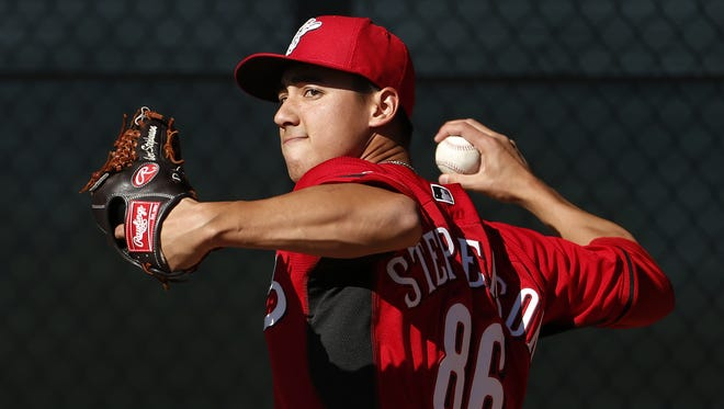 Robert Stephenson throws during practice at Reds spring training and player development complex in Goodyear, Arizona, Feb. 17, 2014. The Enquirer/Gary Landers