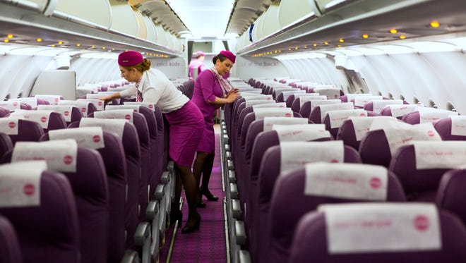 WOW Airlines celebrated its first flight from CVG on May 9. The plane took off for the five-and-a-half hour flight to Iceland at 12:50 am on May 10. So much purple! Flight attendants' uniforms are designed to be noticed. They embrace a vintage look from the glamorous golden age of Pan Am from the 1960's.
