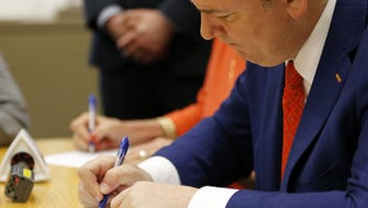FC Cincinnati president and general manager Jeff Berding signing the revised community benefit agreement.