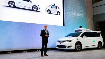 John Krafcik, CEO of Waymo Inc., the autonomous vehicle company created by Google's parent company, introduces a Chrysler Pacifica hybrid outfitted with Waymo's own suite of sensors and radar at the North American International Auto Show