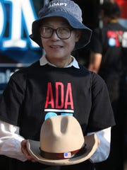 ADA CELEBRATION: Yoshiko Dart holds a hat that belonged to her late husband, Justin Dart. Dart wore the hat when he sat next to President George H.W. Bush as he signed the Americans with Disabilities Act 25 years ago Sunday.