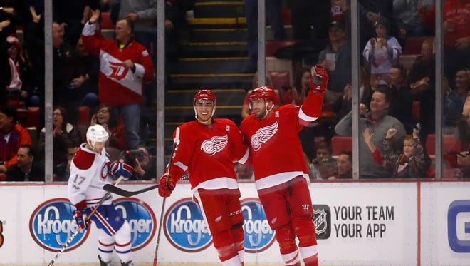 Red Wings forward Thomas Vanek, right, celebrates his second period goal with Andreas Athanasiou during the Wings' 1-0 win Monday at Joe Louis Arena.