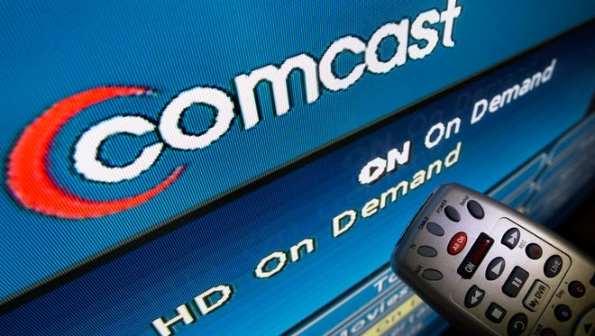 The Comcast logo is displayed on a TV set in North Andover, Mass.