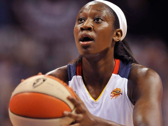 FILE - In a June 15, 2012, file photo Connecticut Sun's Tina Charles shoots a free throw in the first half of a WNBA basketball game against the New York Liberty in Uncasville, Conn.  People familiar with the situation say the Connecticut Sun have agreed to trade Tina Charles to New York for players to be named later and the Liberty's first round pick in 2015.  (AP Photo/Jessica Hill, file)