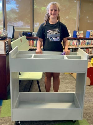 Ivy Yates assembles a craft cart for the Mendon Public Library in Honeoye Falls.