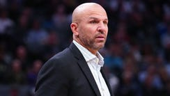 Milwaukee Bucks head coach Jason Kidd looks on from