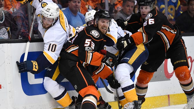 Nashville Predators center Colton Sissons (10) is slammed against the boards by Anaheim Ducks defenseman Shea Theodore (53) during the first period of game 1 of the Western Conference finals at the Honda Center in Anaheim, Calif., Friday, May 12, 2017.