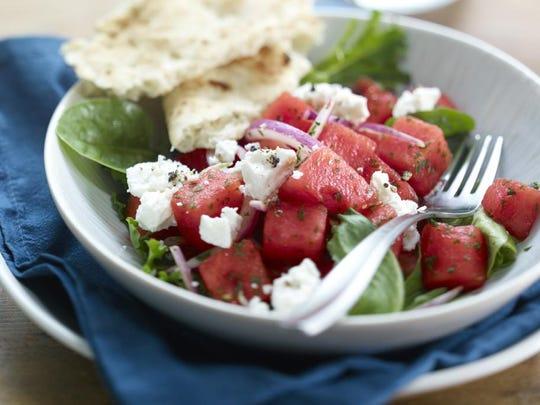 Onion and feta spike a watermelon salad.