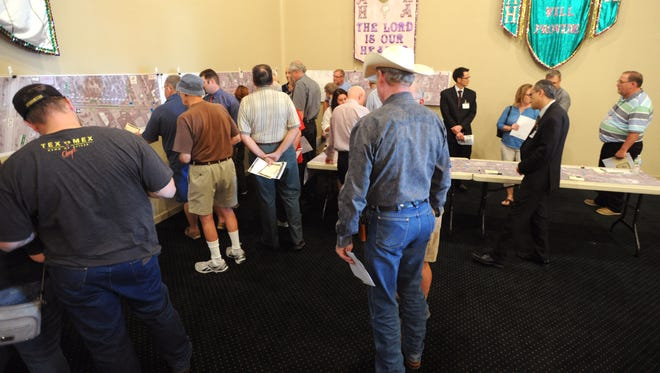 People gather for a public meeting on proposed improvements to Farm Road 89 (Buffalo Gap Road) from Chimney Rock Road to U.S. Highway 83/84.