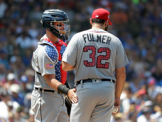 Tigers catcher James McCann, left, talks with pitcher