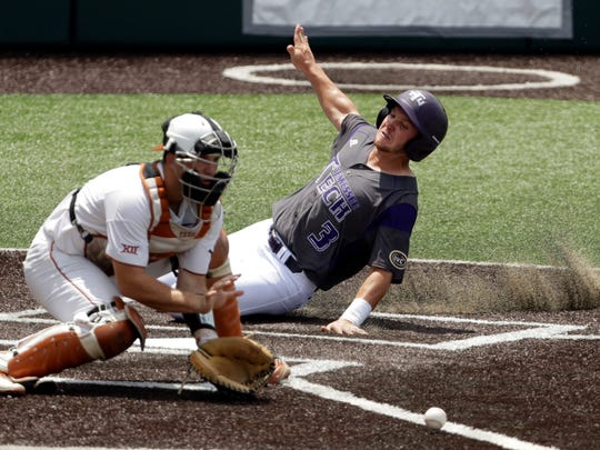 Tennessee Tech's John Ham (3) scores past Texas catcher DJ Petrinsky (6) in the third inning of an NCAA college super regional baseball game, Saturday, June 9, 2018, in Austin, Texas. Ham scored on a hit by teammate Brennon Kaleiwahea.