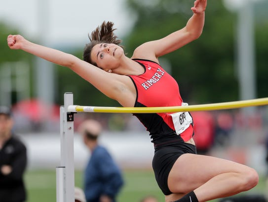 Kimberly's Emily Scott stretches over the bar in the