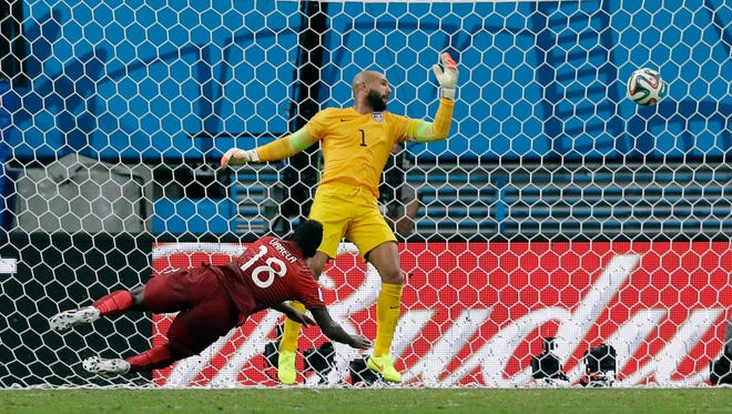 Portugal's Varela heads the ball past U.S. goalkeeper Tim Howard to score his side's second goal and tie the match 2-2 on Sunday.