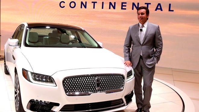 Mark Fields, the president and CEO of the Ford Motor Company, stands in front of the all new 2017 Lincoln Continental that was revealed during the 2016 North American International Auto Show held at Cobo Center in downtown Detroit on Wednesday, Jan. 12, 2016. 