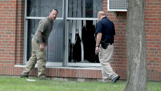 Law enforcement officials investigate an explosion at the Dar Al-Farooq Islamic Center in Bloomington, Minn., on Saturday, Aug. 5, 2017.