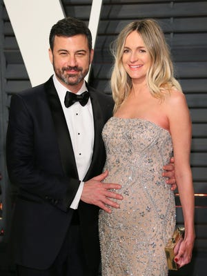 Jimmy Kimmel, left, and his wife, Molly McNearney, arrive at a post-Oscars party in February. Their newborn son underwent successful open-heart surgery last week.