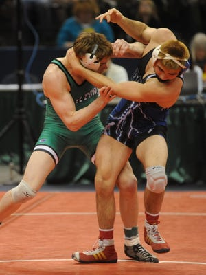 Yorktown's Brad Laughlin wrestles Franklin Central's Jordan Vaughn in the third-place match on Feb. 20, 2016 at Bankers Life Fieldhouse in the IHSAA state wrestling championship. Laughlin won the bout, taking home third place as a junior.