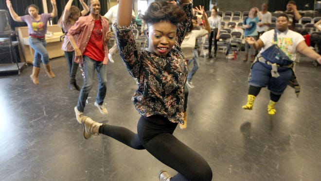 Milwaukee High School of the Arts sophomore Janiyah Moore leaps through the air as she works on a choreographed dance at Milwaukee High School of the Arts in 2014.