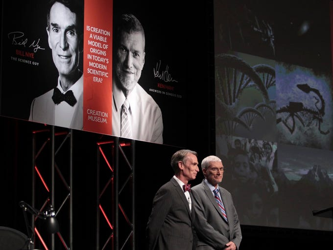 Bill Nye and Ken Hamm greet the audience at the beginning of the Creation Debate at the Creation Museum in Northern Kentucky.