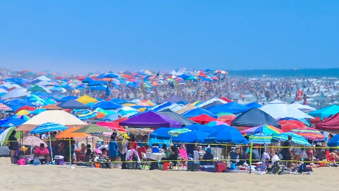 The 4th of July in Ocean City is bumper to bumper cars, people, and umbrellas.