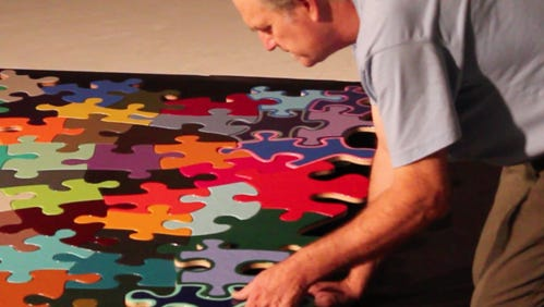 Muncie artist Kevin Campbell is shown working on his Puzzle Project, which will be displayed at Gordy Fine Art and Framing Company beginning Thursday, March 1, 2018.