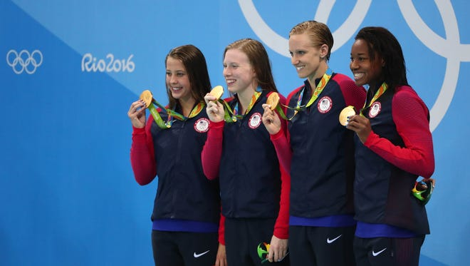 (Left to right) Kathleen Baker, Lilly King, Dana Vollmer and Simone Manuel celebrate after winning the gold medal in the women's 4x100m medley relay final in the Rio 2016 Summer Olympic Games at Olympic Aquatics Stadium.