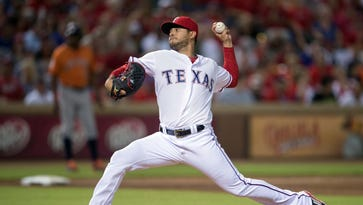 Texas Rangers starting pitcher Martin Perez (33) pitches
