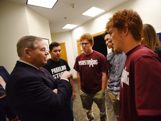 U.S. Sen. Bob Menendez talks to Parkland survivors, from left, Harris Jaffe, Matthew Deitsch, David Hogg and Ryan Deitsch before the rally for gun legislation at Temple B'nai Abraham in Livingston on Sunday, Feb. 25, 2018.