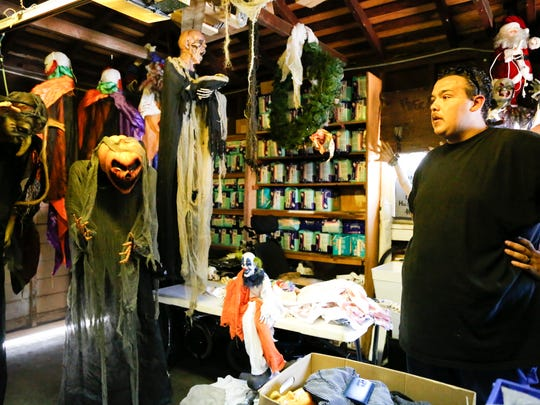 "Troy Garcia shows some of the props he has collected through the years for ""You're Next Haunted Attraction."" He is taking a break this year as he figures out how to deal with city requirements given that the attraction at his home drew more than 500 people last year."