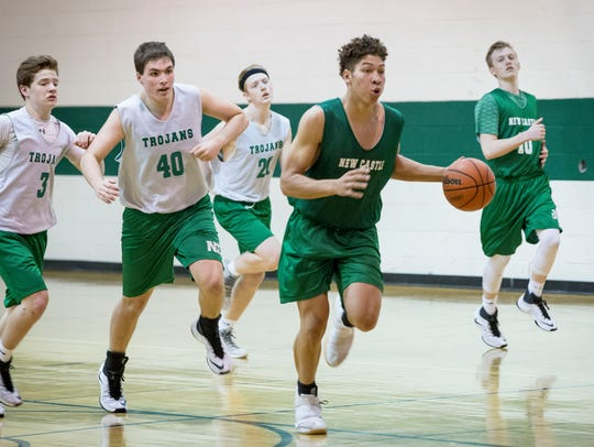 Mason Gillis runs drills with the New Castle basketball