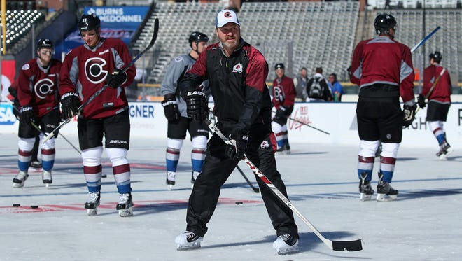 Colorado Avalanche coach Patrick Roy skates with the team during a practice at Coors Field on Feb. 26, 2016, in Denver.