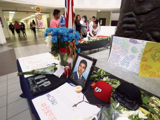 Students stop by a memorial in the routunda of Chapin High School in memory of senior Edgar Vargas, who died in a traffic accident last week in Colorado. Assistant Principal Al Nava said Friday that Vargas had many friends at the school of more than 1,900 students and said hundreds have stopped by to view the memorial.