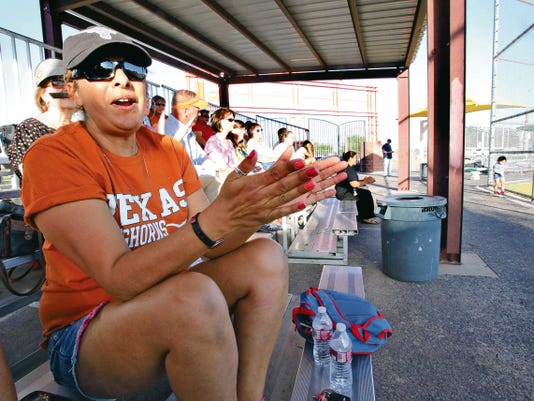Rudy Gutierrez—El Paso Times Pat Cruz urges on her son, Marcario Sanchez on the Field of Miracles Thrusday.