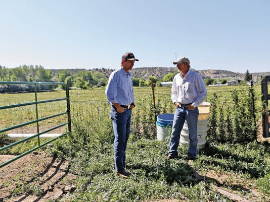 Rancher Jarod Ray, right, talks with U.S. Senator Martin Heinrich, D-N.M., on Friday at his BR Homestead Ranch in Aztec.