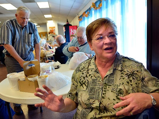 Linda Hivner, 68, of Red Lion, talks Thursday about the decision to not raise Social Security rates this year. She and other volunteers and residents of the Red Lion Senior Home voiced their concerns after Thursday's announcement that there would be no cost of living adjustment on next year's benefits.