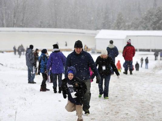 Fans make their way to favorite viewing points between runs during the Luge World Cup at the Olympic Sports Complex in Lake Placid last Saturday. Trudging up the mountain was a daily routine for spectators at last weekend's competition.