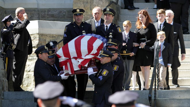 The casket of Yonkers police Lt. Roy McLaughlin, 38, is carried from St. John the Baptist Catholic Church in Yonkers Sept. 14, after a funeral Mass. He helped rescue efforts at Ground Zero after 9/11 and leaves behind his wife, Christine, and four children.
