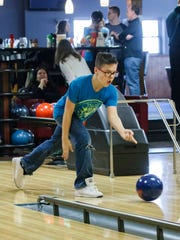 Nolan Pfister, 13, of Sussex throws a ball during the bowling fundraiser hosted by Helping Hands Healing Hooves at Cedars III Bowling Center in Cedarburg on Sunday, Feb. 25, 2018. Helping Hands Healing Hooves is a nonprofit organization with the goal of providing therapeutic, assisted riding programs for individuals with special needs or disabilities.